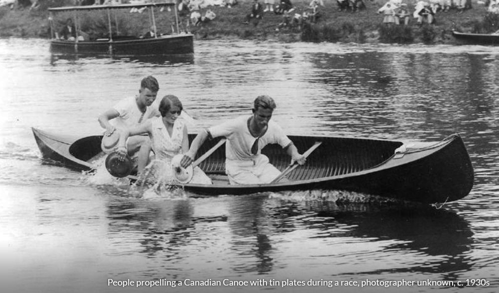 People propelling a Canadian Canoe with tin plates during a race, photographer unknown, c. 1930s